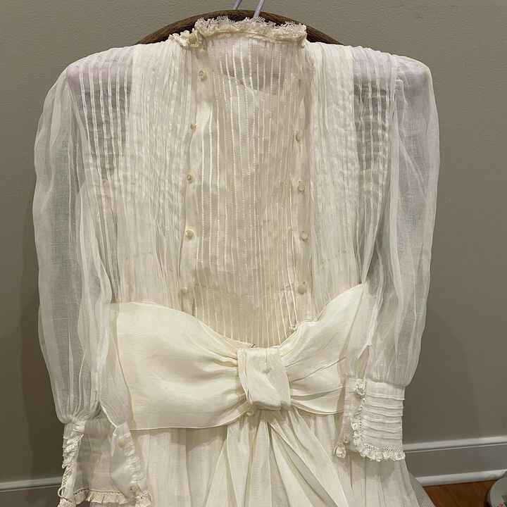 When a little girl wants to wear her grandmother's 1940's First Communion Dress for her same commitment ceremony, you fi...