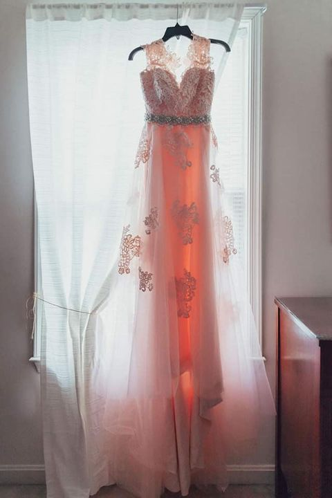Why a pink wedding dress?There are a few dresses at St. Anthony's that stray from the traditional coloring of what most ...
